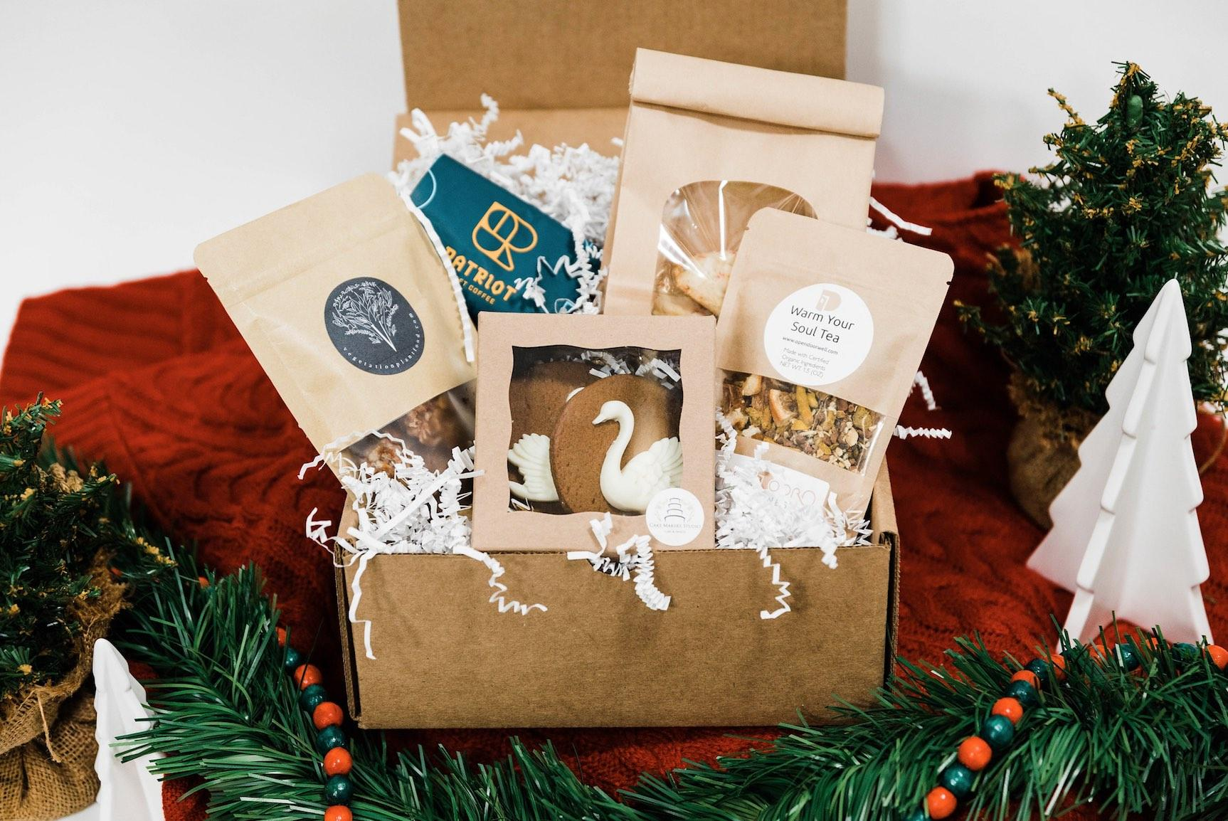 Small gift box with assortment of treats and goodies